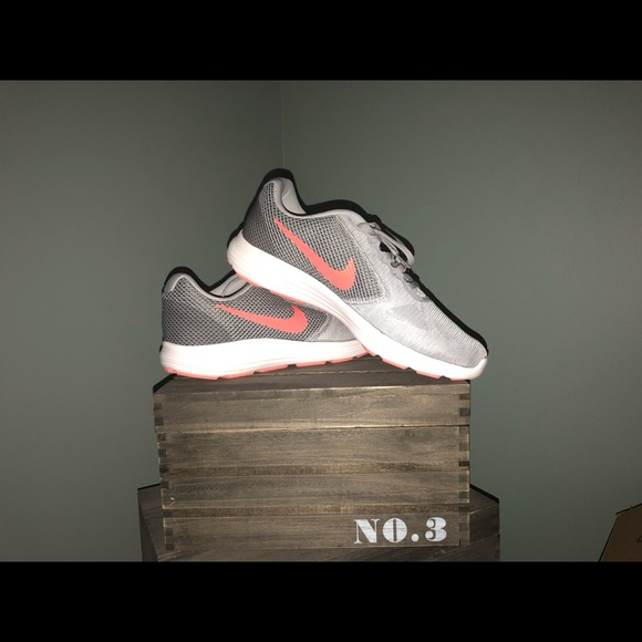 Size 11 (wide) Nike Running Shoes. Brand New.